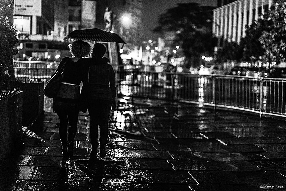 Girls umbrella Rainy Nairobi at Night ©Msingi Sasis.